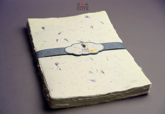 Handmade paper with blue petals